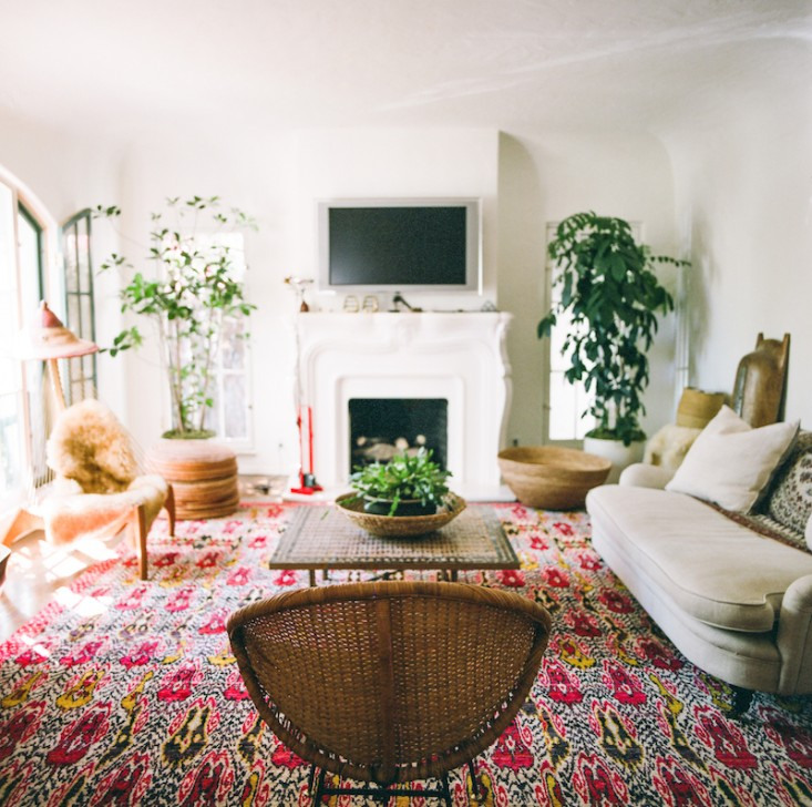 The Rug And Woven Chair Add A Boho Feel To Neutral Room